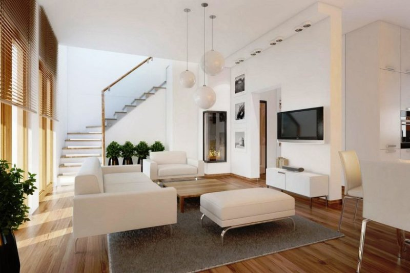 moderne minimalistisk stue-design-eith-tre-hvide-bolde-vedhæng-lamper-over-square-træ-kaffe-table-a