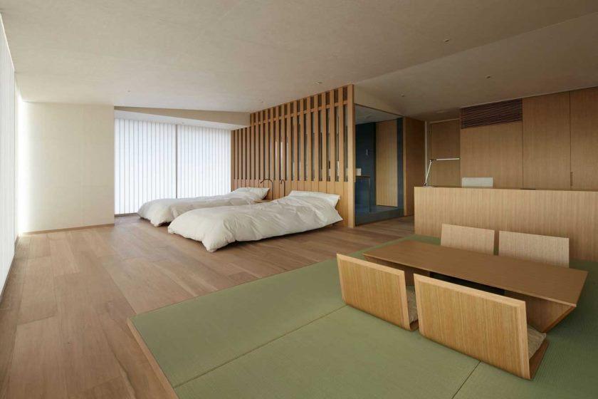 Minimalistisk soveværelseskoncept til åbent rum